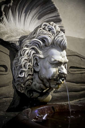 sweltering: Detail of the ancient drinking fountain in Florence Stock Photo