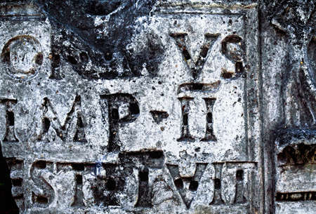 The ancient stone slab  with latin inscription