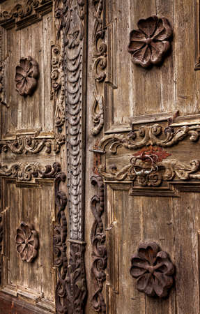 architectonic: Architectonic detail of the aged grunge wooden door