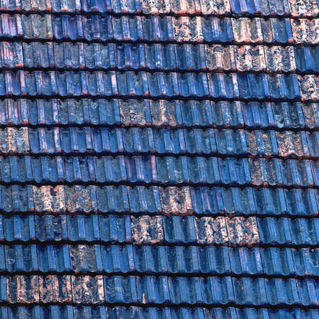 damaged roof: Closeup of old and damaged roof tiles Stock Photo