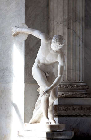 The ancient marble statue of discus thrower Stock Photo