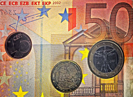Euro coins with euro banknote close up Stock Photo