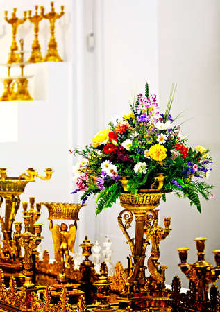 The detail of golden historical tableware with flowers Stock Photo