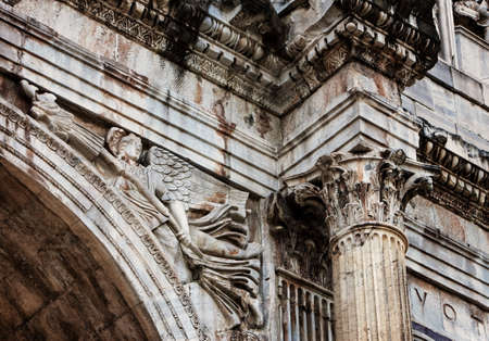 column arch: Detail of the column and relief in the arch of Constantine in Rome, Italy