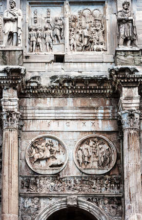 Detail of the column and relief in the arch of Constantine in Rome, Italy