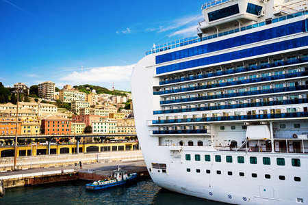 The detail of a cruise ship docked in the harbor of Genova, Italy
