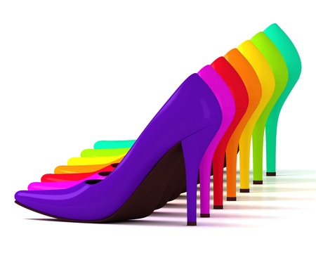 Multicolored fashionable high heel shoes isolated on white background standing in a row photo