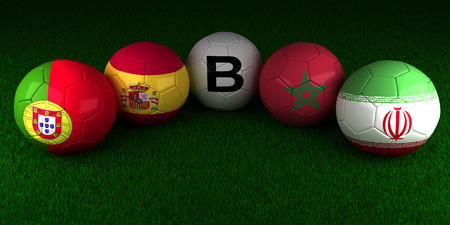balls with the flag of Group B Portugal Spain Morocco Iran on the green grass of stadium 스톡 콘텐츠