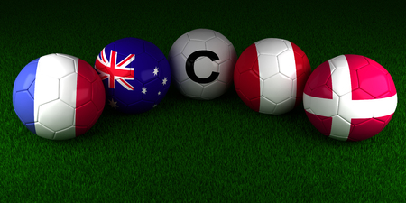Soccer World Cup 2018 balls with the flag of Group C France Australia Peru Denmark on the green grass of stadium