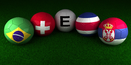 World Cup balls with the flag of Group E Brazil Switzerland Costa Rica Serbia on the green grass of stadium 스톡 콘텐츠