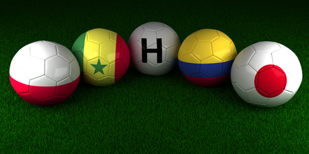 Soccer World Cup 2018 balls with the flag of Group H Poland Senegal Colombia Japan on the green grass of stadium