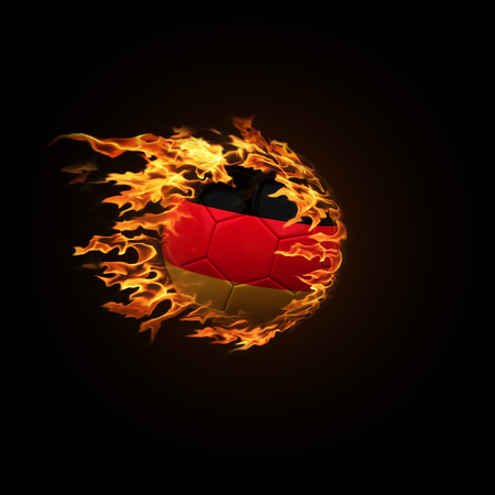 A soccer ball with the flag of Germany burning with fire flies on a black background 3d render 스톡 콘텐츠