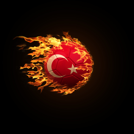 A soccer ball with the flag of Turkey burning with fire flies on a black background 3d render