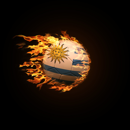 A soccer ball with the flag of Uruguay burning with fire flies on a black background 3d render 스톡 콘텐츠