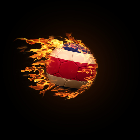A soccer ball with the flag of Costa Rica burning with fire flies on a black background 3d render Stock Photo