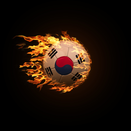 A soccer ball with the flag of South Korea burning with fire flies on a black background 3d render Stock Photo