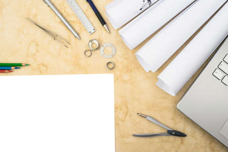 applied: Drawings, components and design tools on the table of an engineer or designer illustrating research and development process in engineering and science.