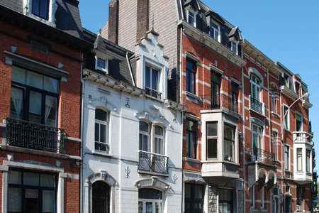 Eclectic old roofs and architectural details, such as windows, attics, balconies in the city of Liege, Belgium.