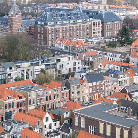 attics: Vintage tiled roofs in the old downtown of Delft, Netherlands in the beginning of spring. Stock Photo