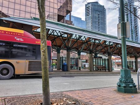 Bellevue, WA  USA - circa December 2019: View of a Rapid Ride bus pulled up at the Bellevue Transit Center downtown with no people around. Editorial