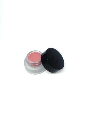 Top view of a cloudy, transluscent blush container with a black lid unscrewed next to it Reklamní fotografie