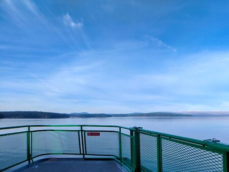 Wide angle view of the San Juan Islands from the rear of an Anacortes Ferry in Washington.