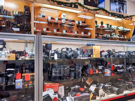Bellevue, WA  USA - circa December 2019: Interior view of Omega Photo store, displaying vintage and newer cameras and lenses for sale behind a glass case.