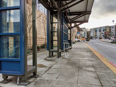 Kirkland, WA  USA - circa January 2020: Exterior view of a bus bay at the downtown Kirkland Transit Center near the King County Library and parking garage.