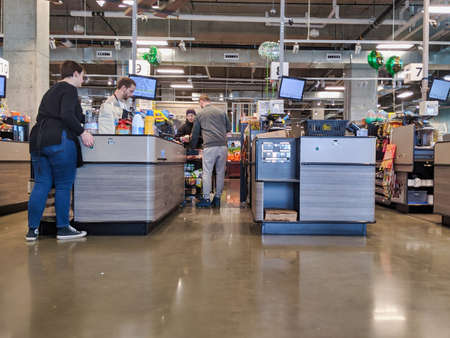 Kirkland, WA  USA - circa March 2020: View of customers shopping for groceries at QFC during the COVID-19 coronavirus panic.