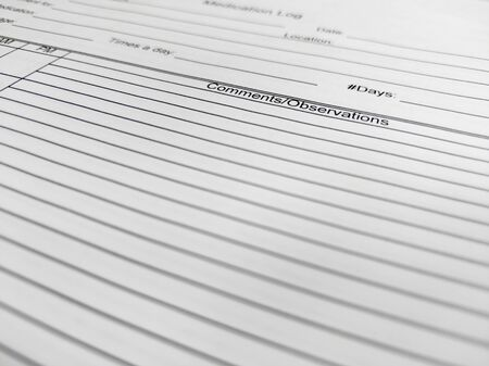 Selective focus on a medical observation log, used to monitor a patient and their symptoms