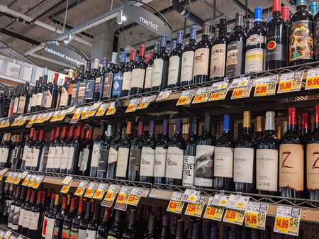 Seattle, WA / USA - circa April 2020: View of a wide wine selection inside a QFC grocery store. Editorial
