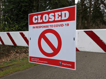 Kirkland, WA / USA - circa March 2020: Close up on a Closed Due To COVID-19 sign at a public park in King County during the coronavirus pandemic.