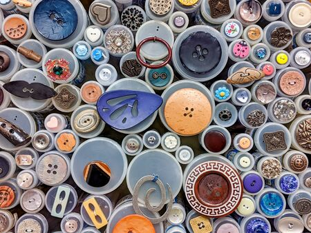 Colorful, vibrant assortment of buttons and other clothing decorations on display in a yarn shop