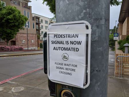 Kirkland, WA / USA - circa May 2020: Automated pedestrian crosswalks in downtown Kirkland to keep people safe during the coronavirus