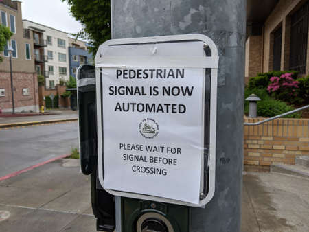 Kirkland, WA / USA - circa May 2020: Automated pedestrian crosswalks in downtown Kirkland to keep people safe during the coronavirus.