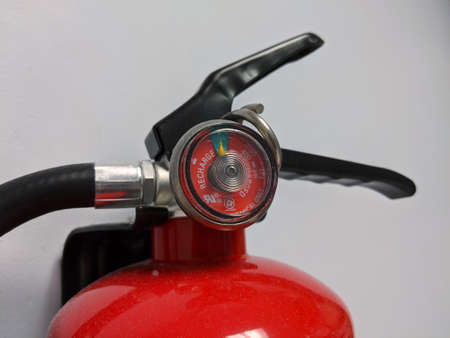 Seattle, WA / USA - circa March 2020: Close up view on a fire extinguisher attached to a wall inside a medical office building.