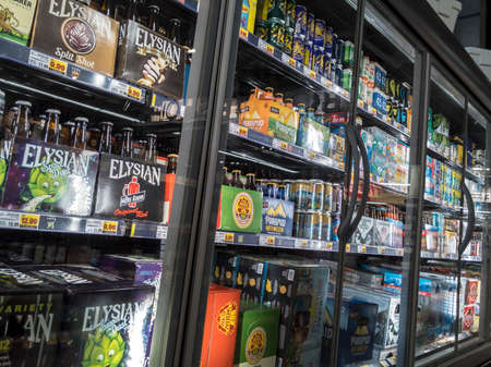 Seattle, WA / USA - circa April 2020: Selective focus on refrtigerated beer display case inside the QFC grocery store, displaying Corona beer and other brands. Editorial