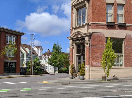 Kirkland, WA / USA - circa May 2020: Street view of a Windermere Real Estate office building in downtown on a sunny day.