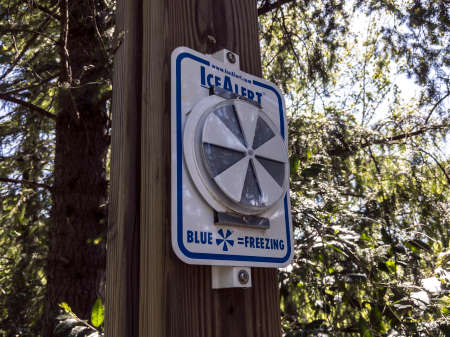 Snoqualmie, WA / USA - circa May 2020: View of an Ice Alert warning sign on a wooden post in the historic Snoqualmie Falls Park.