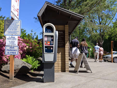 Snoqualmie, WA / USA - circa May 2020: View of a pay-to-park machine at Snoqualmie Falls Park on a sunny day.