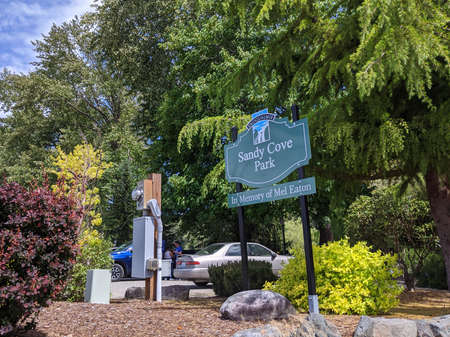 Snoqualmie, WA / USA - circa May 2020: View of the entrance to Sandy Cove Park, a grassy area next to the Snoqualmie River. Editorial