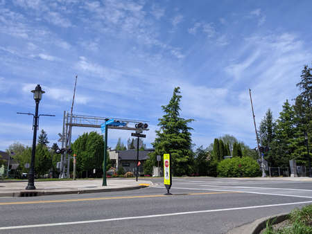 Snoqualmie, WA / USA - circa May 2020: Street view of a State Law: Stop for Pedestrians road sign on a bright, sunny day in the mountains.