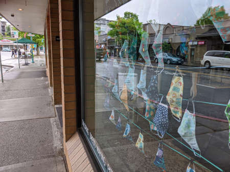 Kirkland, WA / USA - circa May 2020: View of decorative coronavirus face masks for sale inside a local shop downtown. Editorial