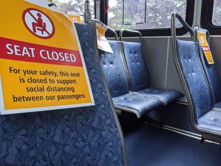 Bellevue, WA / USA - circa June 2020: Social distancing signs on seats inside King County public transit buses