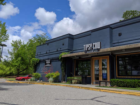 Woodinville, WA / USA - circa July 2020: Curbside view of a Tipsy Cow Burger Bar on a sunny day.