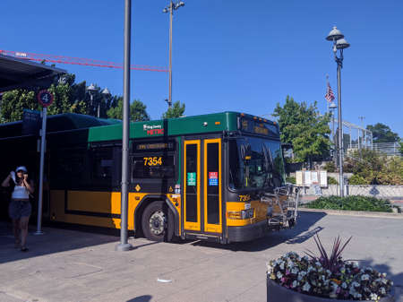 Kirkland, WA / USA - circa August 2020: A King County Metro bus displaying Masks Required on their marquee Editorial