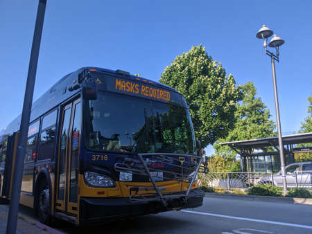 Kirkland, WA / USA - circa August 2020: A King County Metro bus displaying Masks Required on their marquee. Editorial