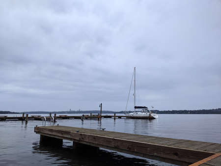 Lone boat docked on Lake Washington on an overcast day