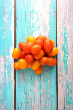 Variety colored of tomato cherry on top wooden table. Tomato cherry is packed with vitamin C, a cherry tomato boosts immunity and acts as an antioxidant