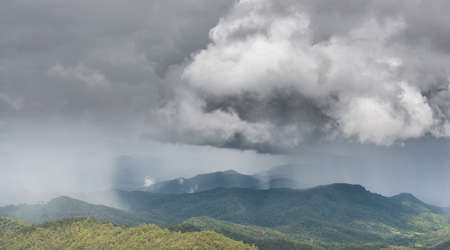 tropical evergreen forest: Rain over the mountain
